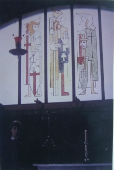 The window at St Timothy's church in 1965, you can see Chris by the altar